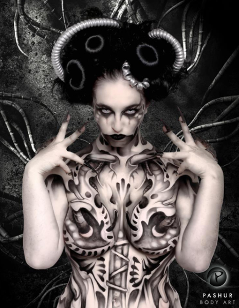 Dark Machine Body Painter: Pashur Model: Odette Despair Photographer: Laura Dark This piece was inspired by a bio-mechanical tattoo I saw online. The entire painting is hand done using only the color black. No airbrushed was used.
