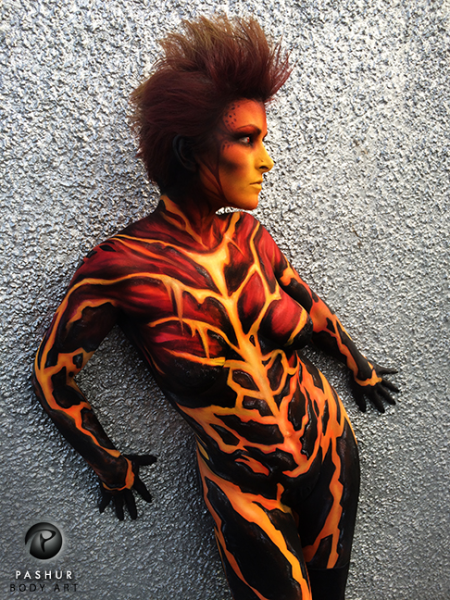 "Magma Body Painter & Photographer: Pashur Model: Laura J Draycon I body painted this piece while visiting Edinburgh, Scotland as a Special Guest for the UK Body Paint League. I took a tiny reference pic of molten lava (also attached) as seen through my ""X-Ray"" body paint templates that I created. I then expanded on it creating the magma rock down the model's abs, legs and arms. I took the pic with my iphone against a silver wall outside of the studio."