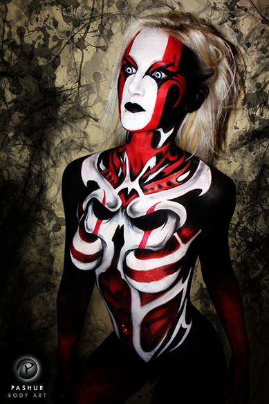 Rapture Body Paint & Photographer: Pashur Model: Lacrisha Garver I created this design at the Midwest Haunters Convention for their body art showcase. I wanted to create a piece that had elements of Kabuki make-up as well as the style of HR Giger. The model had several tattoos to cover quickly, so I used lots of black.