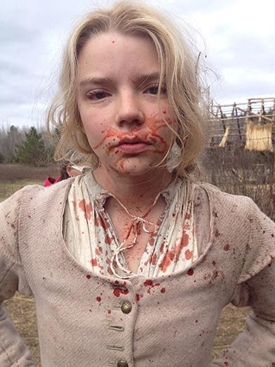 Anya Taylor Joy with a little blood splatter as Thomasin