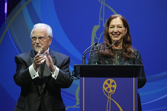 Tommy Cole and Sue Cabral-Ebert speak onstage at the 2017