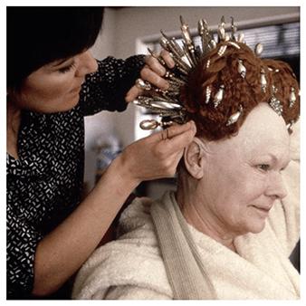 Dame Judi Dench having her wig adjusted